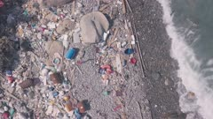 Climate change is impacted by beach covered in plastic and rubbish in Hong Kong. Aerial drone view