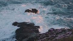 Waves Crashing On The Rocky Shore In Guernsey - Closeup Shot