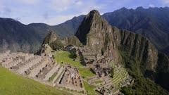 Machu Picchu ruins and terraces view from above, on a sunny day, Peru