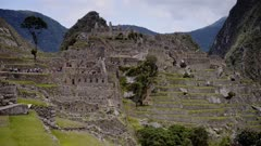 Machu Picchu ruins and terraces landscape view, with mountains in the background, Peru