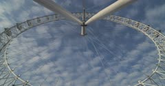 Timelapse of The London Eye, a London time lapse of clouds moving and blue sky at the famous tourist attraction building, stationary due to the Covid-19 Coronavirus pandemic lockdown, England, Europe