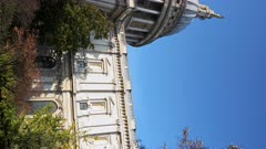 Vertical video of popular London tourist attraction and landmark of St Pauls Cathedral on a bright blue sky day with Autumn trees, shot in the Coronavirus Covid-19 Lockdown in England, Europe