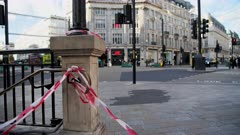 Oxford Circus Underground Tube Station, closed in the Covid-19 Coronavirus lockdown in London, with quiet empty roads at Oxford Street, the popular tourist destination high street in England, Europe