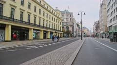 The Strand, a quiet and empty street in Central London in the Covid-19 Coronavirus lockdown with closed shops shut down at the popular shopping high street in Westminster, England, Europe
