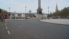 Quiet, empty streets in London with no cars or traffic during Coronavirus Covid-19 pandemic lockdown at Trafalgar Square and Nelsons Column in London in the City of Westminster, England, UK