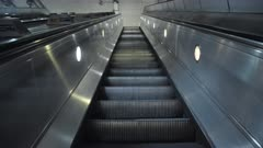 Quiet escalator in London Underground tube train station in Covid-19 Coronavirus pandemic lockdown in England, UK deserted with no people at rush hour