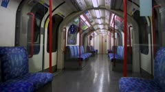 Empty Seats in London Underground tube train carriage in Covid-19 Coronavirus lockdown pandemic in England, UK showing no people, quiet and deserted