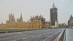 Empty quiet roads in London in Coronavirus Covid-19 lockdown at Westminster Bridge with Houses of Parliament and Big Ben and people cycling and walking in England, UK
