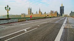 London in Coronavirus Covid-19 lockdown with empty quiet deserted streets with no cars or traffic at Westminster Bridge with Houses of Parliament and Big Ben in England, UK