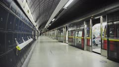 London Underground tube train in Covid-19 Coronavirus lockdown pandemic in England, UK showing London Bridge Station empty, quiet and deserted with no people on the platform