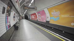 London Underground tube train in Covid-19 Coronavirus lockdown pandemic in England, UK showing St Pauls Station empty, quiet and deserted with no people on the platform