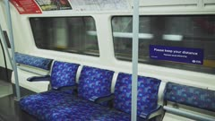 Empty Seats in London Underground tube train carriage in Covid-19 Coronavirus lockdown pandemic in England, UK showing no people, quiet and deserted at rush hour
