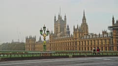 London in Coronavirus Covid-19 lockdown with empty quiet deserted roads and streets with no cars or traffic at Westminster Bridge with Houses of Parliament in England, UK at rush hour