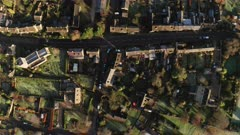 Aerial drone video of a Cotswolds Village, a rural scene in English countryside with houses, property and real estate in the UK housing market, top down vertical shot of Bourton on the Hill, Gloucestershire, England