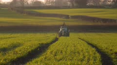 Farmer sprays pesticides onto crops in Somerset, United Kingdom