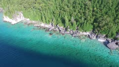 Stunning aerial reveal shot of the beautiful rocky cliffs of Bruce Peninsula