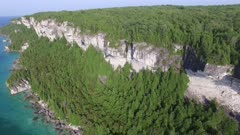 Slowly moving shot of Bruce Peninsula cliffs in Canada during summer