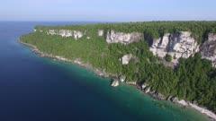Drone pans while flying to expose long peninsula part of Niagara Escarpment