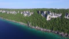 Beautiful cliffs of Georgian Bay scene by drone flying alongside of it