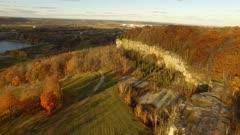 Drone flight near steep rocky hills at ski center