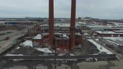 Drone flying through two chimneys at abandonned incinerator