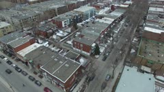 Slow aerial reveal shot of Montreal's Olympic Stadium