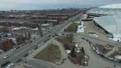 Aerial view of pedestrians and cars moving near stadium complex