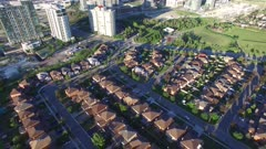 Very slow aerial reveal shot of skycrapers in Canadian city in the sun