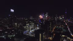 Sideway aerial flight over Toronto during Canada Day fireworks celebrations