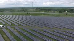Aerial circling shot of a high-tech solar panel farm in North America