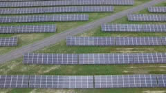 Slow drifting drone motion over geometrical array of solar panels