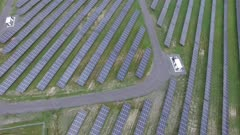Overhead view of multiple solar panels producing clean sustainable power