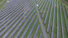 Impressive drone reveal shot of solar farm used to create clean energy