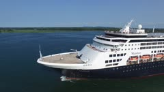 Stunning drone rising shot of large Maasdam cruise vessel while moving
