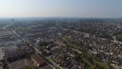 Drone view moving across the city towards a soccer field