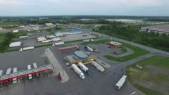 Drone flying backward showing large truck gas station in North America