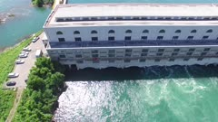 Slow aerial gliding sequence of hydroelectric power generation dam in operation