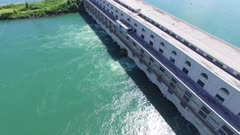 Drone flying slowly revealing hydro electricity renewable energy power plant