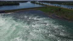 Powerful swirl created in Canadian river by hydroelectric energy generator