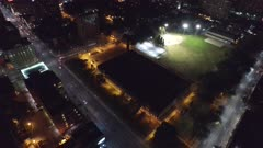 Fixed drone footage above baseball field at night