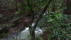 Heavy water flow cascades down rocky terrain in Panama rainforest jungle