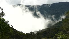 Clouds quickly changing shape in pure mountainous scenery