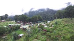 Rural structures atop a mountain peak in the cloud forest of Costa Rica