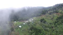 Aerial view of pretty village on hillside with road in Central America