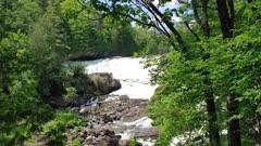 Energetic waterfall shines background evergreen woods truck