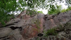 Marvellous Stone cliff wall outcrop in woods low angle