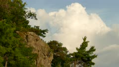 Bright sunny summer day cliff cloud movement sky static