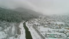 First Snow - Mountain Side River Running Next To Village and Christmas Tree Forest