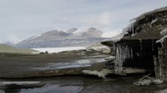 Melting icicles into small stream on the coast of Antarctica Dry Valleys