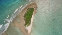 aerial vertical view ascending and spiraling from small tropical island